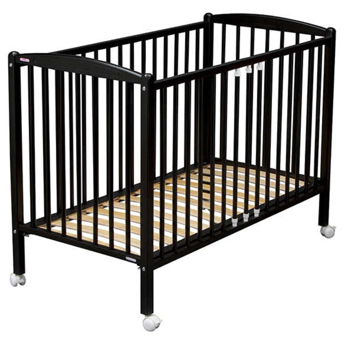 combelle lit b b arthur 60 x 120 cm laqu noir lit b b combelle sur l 39 armoire de b b. Black Bedroom Furniture Sets. Home Design Ideas